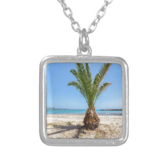 Tropical palm tree on sandy beach silver plated necklace