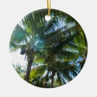 Tropical palms lit by the sun ceramic ornament
