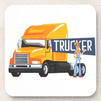 Trucker Standing Next To Heavy Yellow Long-Distanc Coaster