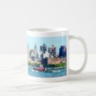 Tugboat Against Manhattan Skyline Mug