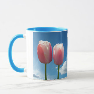 Tulips flowers in blue sky mug