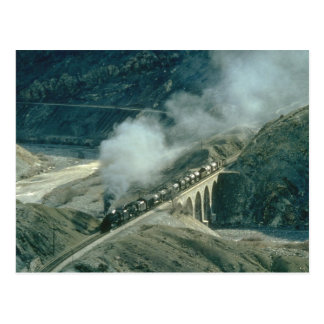 Turkish Middle East 2-8-0's head a tank train for Postcard