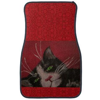 tuxedo cat on red car mat