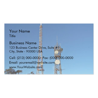 Twin communication towers against blue sky business card template