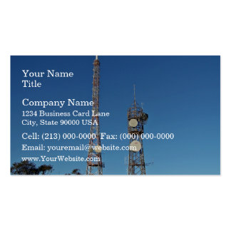 Twin communication towers against blue sky business card