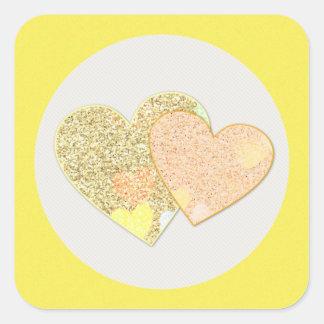 Twin golden glitter hearts square sticker