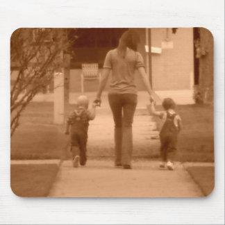 twins walking along sidewalk mouse pad