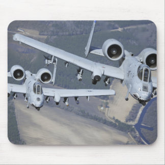 Two A-10C Thunderbolt II aircraft fly in format Mouse Pad