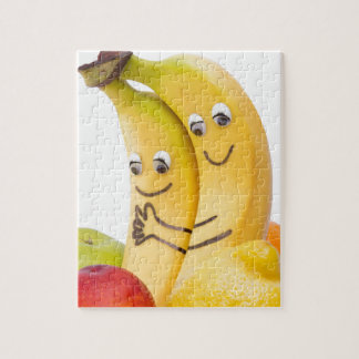 Two bananas with eyes and mouth puzzles
