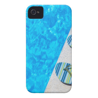 Two bathing slippers on edge of swimming pool iPhone 4 cover