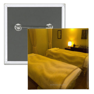 Two beds in the beauty salon, high angle view, 15 cm square badge