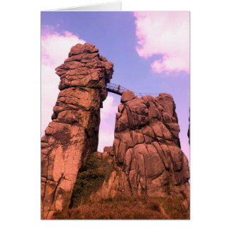 two big rocks and wooden bridge in nature park card