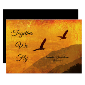 Two birds silhouetted against a golden red sky card