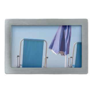 Two blue beach chairs and parasol at sea.JPG Belt Buckle