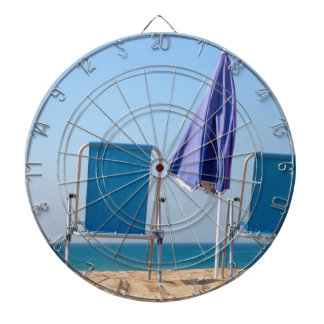 Two blue beach chairs and parasol at sea.JPG Dartboard