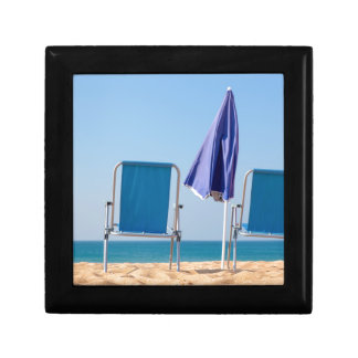 Two blue beach chairs and parasol at sea.JPG Gift Box