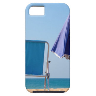 Two blue beach chairs and parasol at sea.JPG iPhone 5 Cover