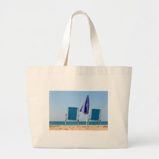 Two blue beach chairs and parasol at sea.JPG Large Tote Bag