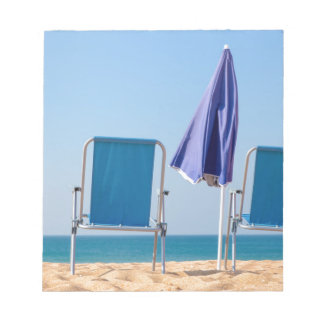 Two blue beach chairs and parasol at sea.JPG Notepad