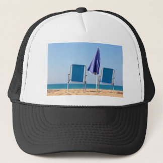 Two blue beach chairs and parasol at sea.JPG Trucker Hat