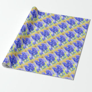 Two blue grape hyacinths in spring wrapping paper