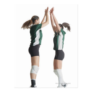 two caucasian female volleyball players from the postcard