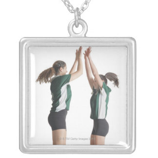 two caucasian female volleyball players from the silver plated necklace