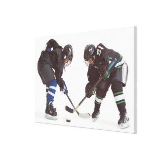 two caucasian hockey players wearing opposing canvas print