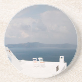 Two chairs on Santorini island Coaster