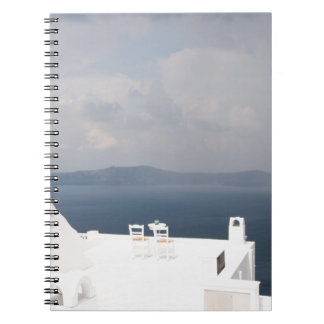 Two chairs on Santorini island Notebook