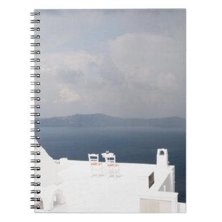 Two chairs on Santorini island Notebooks