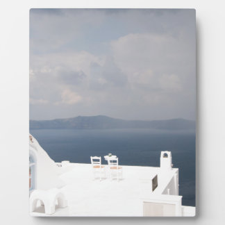 Two chairs on Santorini island Plaque