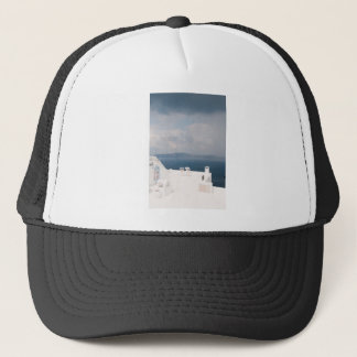 Two chairs on Santorini island Trucker Hat