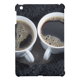 Two cups of coffee wrapped a black wool scarf iPad mini covers