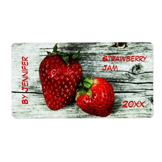 Two deliscious strawberries jam label