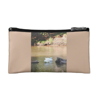 Two ducks in pond makeup bags