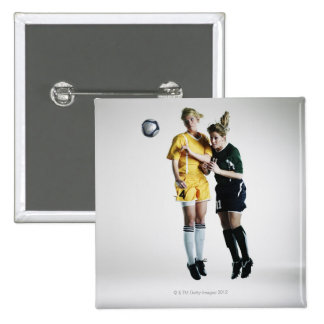 Two female soccer players in mid air heading 15 cm square badge