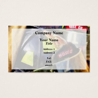 Two Fire Helmets And Fireman's Jacket Business Card