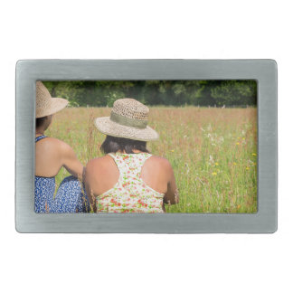 Two friends sitting together in meadow.JPG Belt Buckles