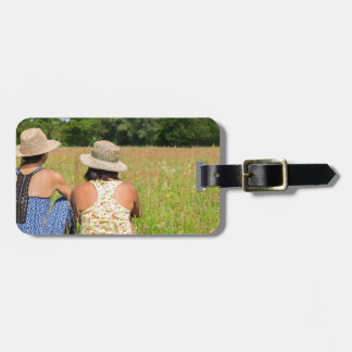 Two friends sitting together in meadow.JPG Luggage Tag