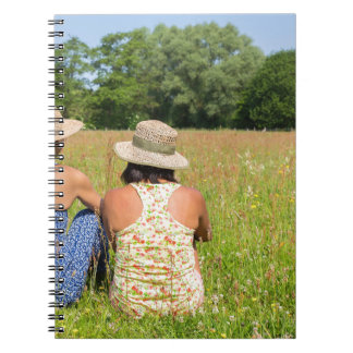 Two friends sitting together in meadow.JPG Notebook