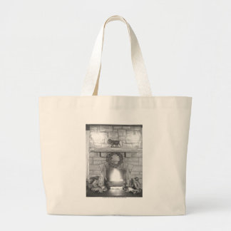 Two girls sitting by a fireplace at Christmas Large Tote Bag