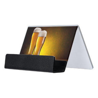 Two glasses of beers on a wooden table desk business card holder