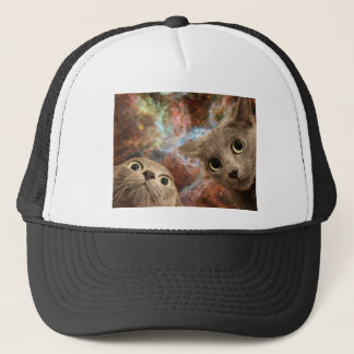 Two Gray Cats in Space Before a Nebula Trucker Hat