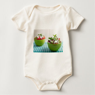 Two green bowl with vegetable vegetarian salad baby bodysuit