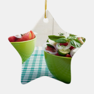 Two green bowl with vegetable vegetarian salad ceramic star decoration