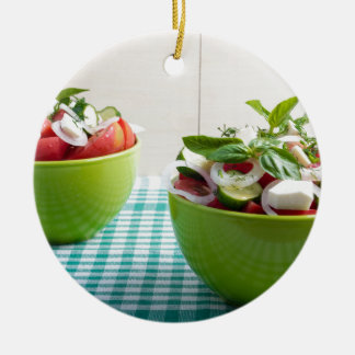 Two green bowl with vegetable vegetarian salad round ceramic decoration