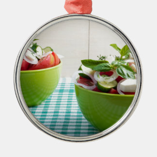 Two green bowl with vegetable vegetarian salad Silver-Colored round decoration