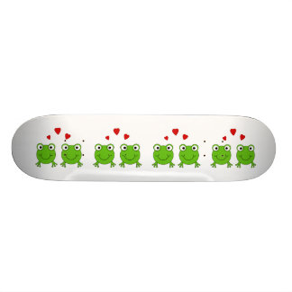 Two green frogs with red hearts. skate board