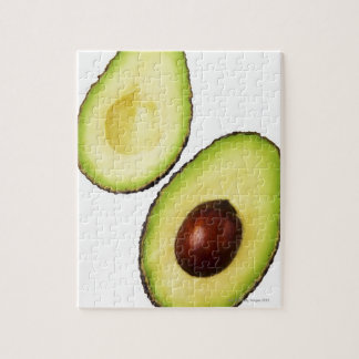 Two halves of an an avocado, on white jigsaw puzzle